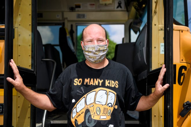 Mike Talarzyk, a contract bus driver for the Evansville Vanderburgh School Corporation, poses for a portrait in front of one of the buses he owns in Evansville, Ind., Friday afternoon, July 24, 2020.