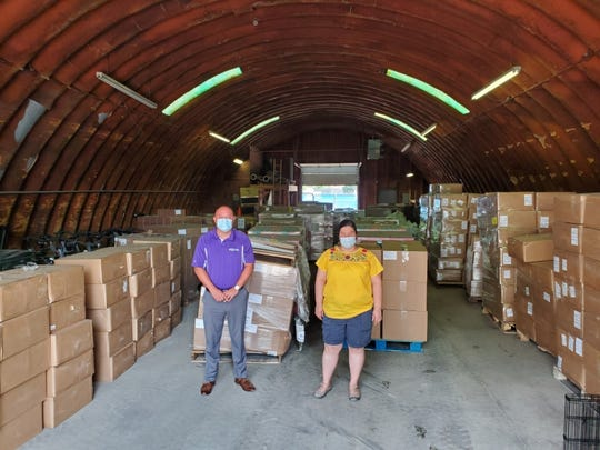 Monica Ramirez, center, stands with Fremont Mayor Danny Sanchez in front of relief supplies donated to aid farmworkers during the COVID-19 pandemic, through the Farmworkers' Pandemic Relief Fund. Ramirez is pushing the state to mandate health and safety standards to help protect farmworkers.