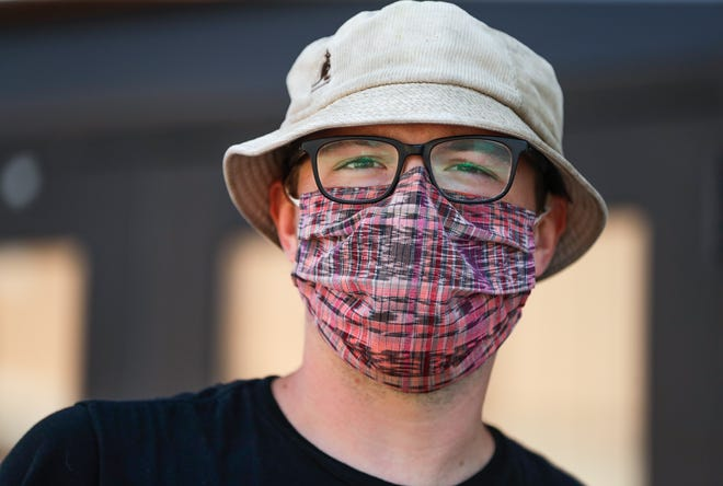"Harry Kispert talks a little bit about the mask mandate on Friday, July 24, 2020, near Khrome on North Broadway in downtown Green Bay. ""I think it should've been in place the whole time, quite frankly,"" he said. ""Its a piece of cloth that will help protect others."""