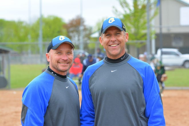 Jeremy Wusterbarth, left, seen at a game with assistant coach Brian Sohrweide last spring, has resigned as softball coach from Oconto High School. He was coach for 11 seasons and assistant coach four years before that.