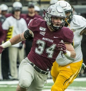 The 2020 football season for Big Sky Conference, including preseason defensive MVP Jace Lewis of Montana (34), has been delayed indefinitely while the league assesses possible COVID-19 impacts.