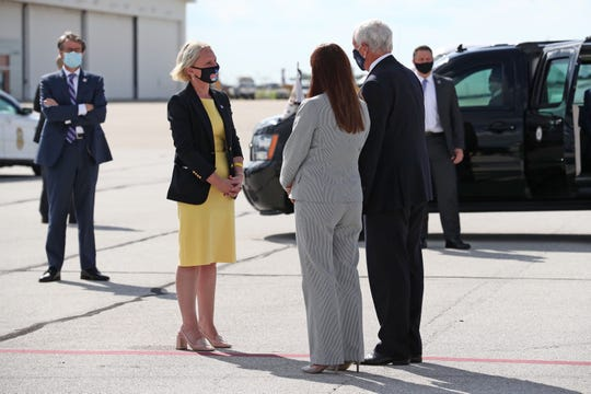 State senator Victoria Spartz, (R) Noblesville greets Vice President Mike Pence and his wife Karen at the Indianapolis International Airport on Friday, July 24, 2020.The couple will meet at Marian University with higher education leaders about safely reopening schools amid the coronavirus pandemic.
