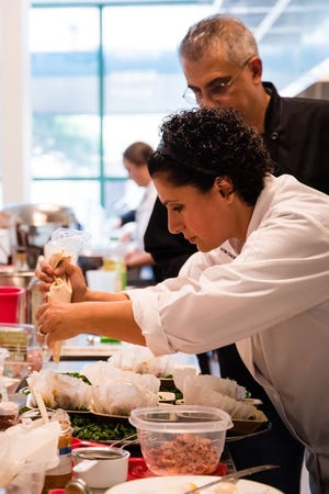 "Linda and Vahik Haddadian compete in ""Final Table: New Orleans""  in 2019 at the the New Orleans Culinary and Hospitality Institute."
