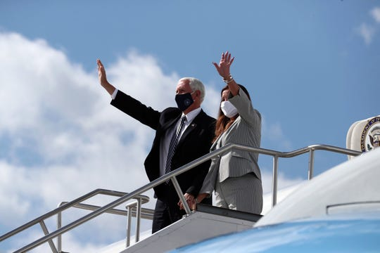 Vice President Mike Pence and second lady Karen Pence wave to the crowd as they disembark Air Force II at the Indianapolis International Airport, Friday, July 24, 2020. The couple will meet at Marian University with higher education leaders about safely reopening schools amid the coronavirus pandemic.