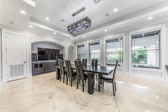 Connected to the kitchen is the formal dining room, outfitted with a full service bar and entertainment center. The home has 5 bedrooms, 3.5 bathrooms, is on the market for $950,000. The Brookshire Gardens subdivision mansion boasts 4,000 square feet.