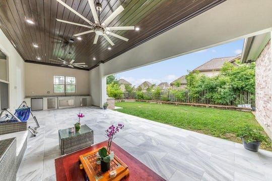 Out back is an airy patio with finished floors and an outdoor grill meant for entertaining friends and family. The home has 5 bedrooms, 3.5 bathrooms, is on the market for $950,000. The Brookshire Gardens subdivision mansion boasts 4,000 square feet.