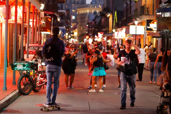 People sing and dance to karaoke on Bourbon Street in New Orleans, Thursday, July 9, 2020.