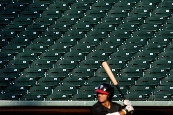 The stands are empty as Lugnuts' Darryn Davis prepares to bat during the second inning on Thursday, July 23, 2020, at Cooley Law School Stadium in Lansing.