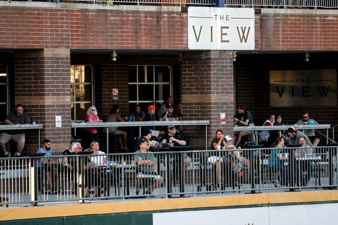 About 100 fans take in the open game of the Lemoande League on Thursday, July 23, 2020, at Cooley Law School Stadium in Lansing.