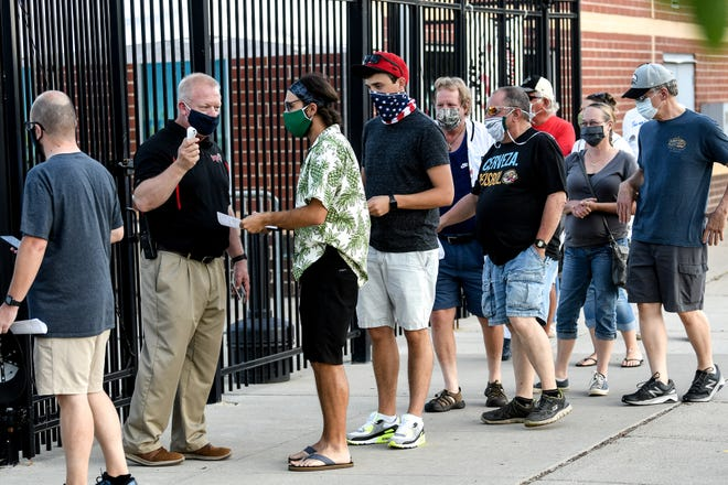 Fans arrive for opening night of the summer baseball Lemonade League on Thursday, July 23, 2020, at Cooley Law School Stadium in Lansing.