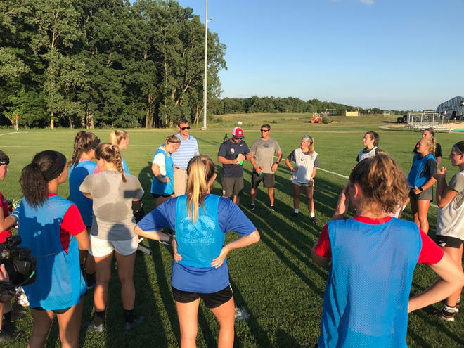 Lansing United coach Jason Crist (in hat) addresses the team at the end of practice on Thursday, July 23, 2020. United will play its only two matches this weekend in the UWS Stadium Showcase at Detroit City FC.