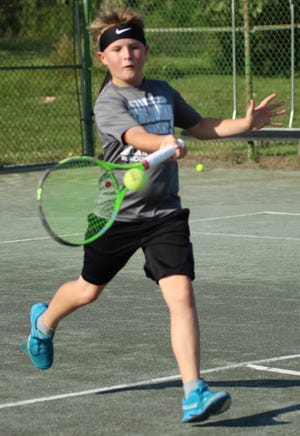 Philip Etzel is one of the bright young stars on the local tennis circuit, having won the boys 10-and-under title the last two years in the News Journal/Richland Bank tournament.