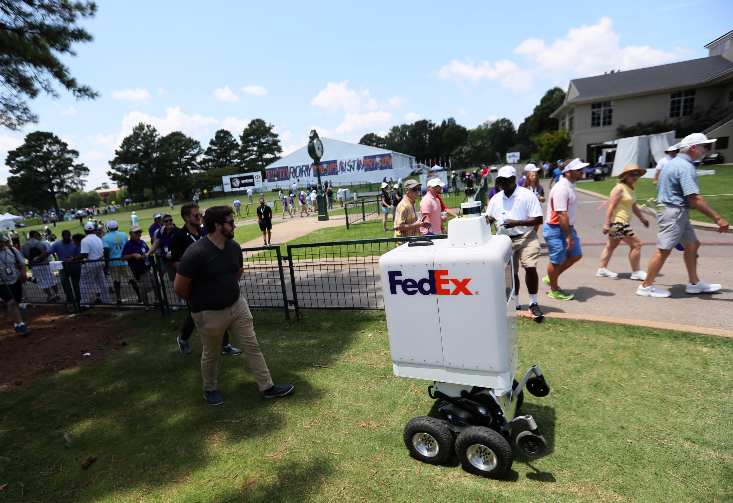 July 24, 2019 - FedEx's automatronic robot Roxo drives past fans at the WGC-FedEx St. Jude Invitational at TPC Southwind.