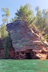 Downed trees line the sandstone cliff above a rock formation that resembles a skull north of Meyers Beach in the Apostle Islands National Lakeshore on July 21, 2020.