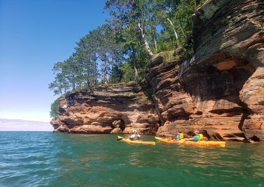 Kayakers paddle along sea caves north of Meyers Beach in the Apostle Islands National Lakeshore.
