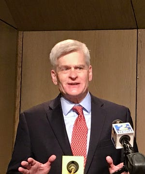 U.S. Senator Bill Cassidy speaks to reporters after qualifying for reelection July 24, 2020.