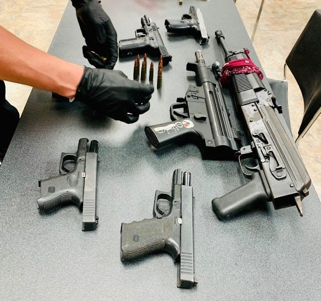 Police confiscated eight weapons, two of which were stolen.
