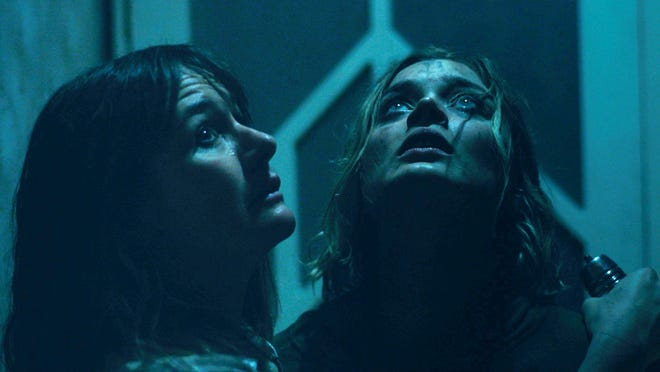 Emily Mortimer and Bella Heathcote check the ceiling in 'Relic.'