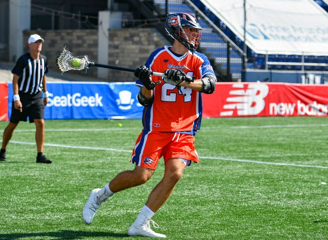 Poughquag native Brendan Sunday, playing for the Philadelphia Barrage, readies to make a pass up field during a July 21 Major League Lacrosse game against the Boston Cannons.