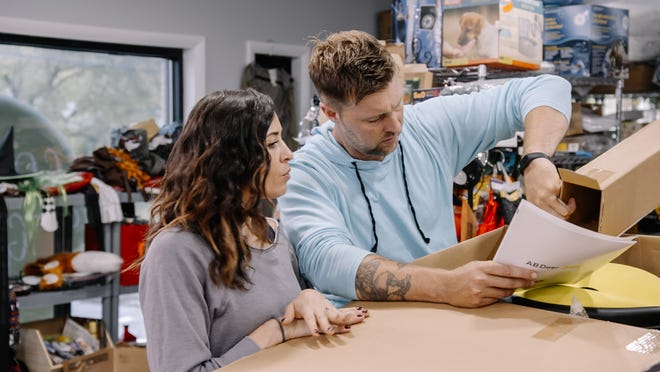 "Salena Ozzimo and Bobby Follett at their Goods Galore store in Gates. The Greece couple stars in the new A&E series ""Extreme Unboxing,"" premiering Aug. 4."