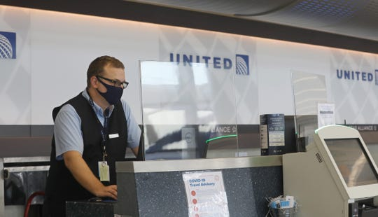 Shields have been installed airline check-in counters, like United, providing safety for both employees and customers at the Greater Rochester International Airport Friday, July 24, 2020.