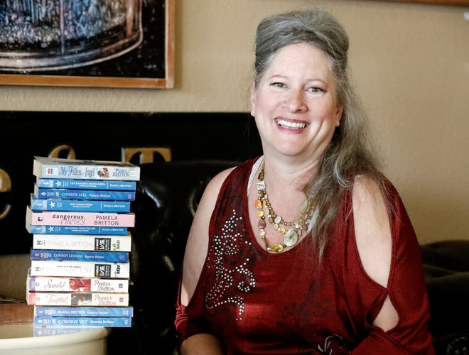 Pamela Britton-Baer poses inside The Bean coffee shop in Cottonwood on July 24, 2020, where she's sat and written many of her romance novels on a laptop.