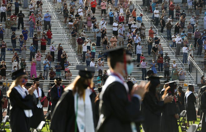 Graduating seniors from South Fork High School participate in the school's in-person commencement ceremony on Friday, July 24, 2020, at the school's stadium in Stuart. The coronavirus pandemic cut short the end of the school year, and delayed the formal in-person graduation ceremonies until this week. The participating graduates walked across the stage, but did not collect diplomas as a precaution to help prevent the spread of the virus.
