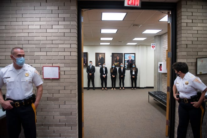 Police recruits line up before taking the oath of office July 24 in Vineland, N.J.