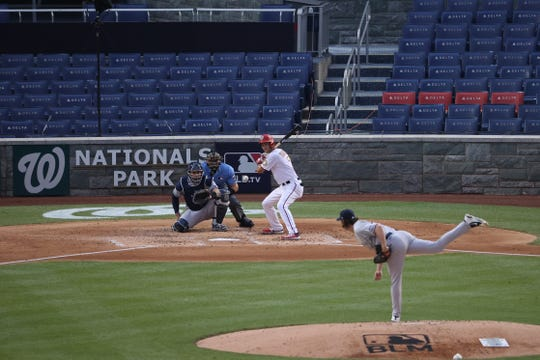 Yankees starting pitcher Gerrit Cole pitches against Nationals shortstop Trea Turner in the fourth inning at Nationals Park in the opener.