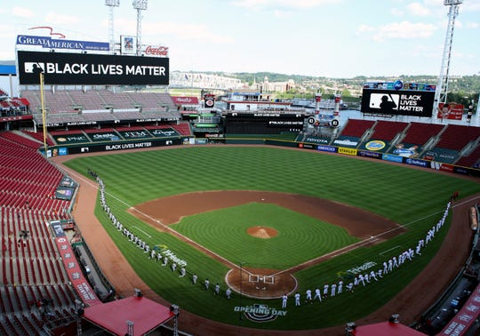July 24: The Cincinnati Reds and the Detroit Tigers take part in Opening Day ceremonies.