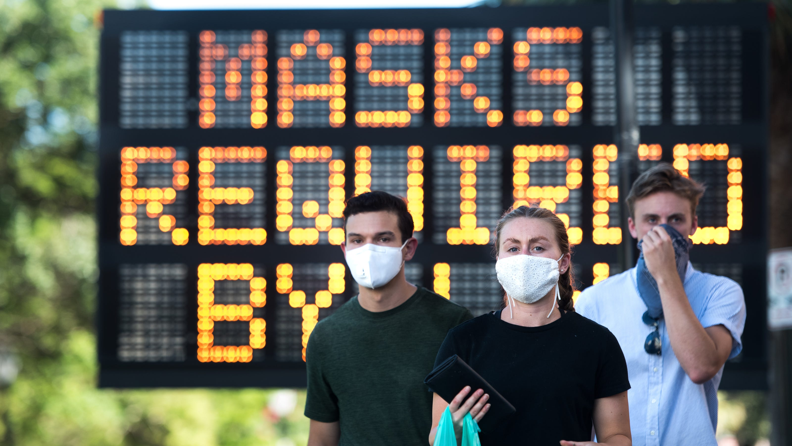Fact check: Masks can keep out COVID-19 particles even though smaller than dry wall dust