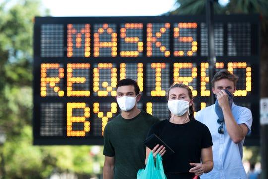 Masked Men July 18, 2020, in Charleston, South Carolina.