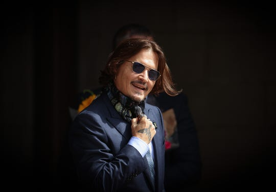 Johnny Depp arrives at court in London on July 24, 2020 for another day in his libel trial against a London tabloid.