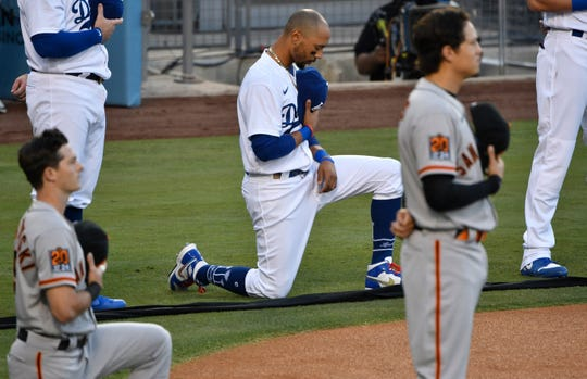 Dodgers outfielder Mookie Betts during the national anthem on Thursday.