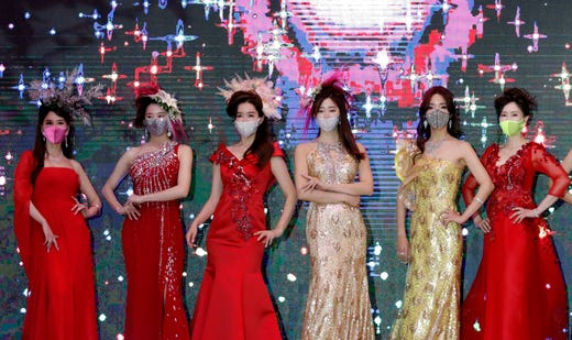 Models wearing masks take part in a mask fashion show in Seoul, South Korea, Friday, July 24, 2020.