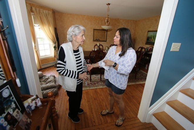 Laura Rios, right, has been helping her mother, AnnaPaulino, with virtual adult day care at their home in Montgomery.