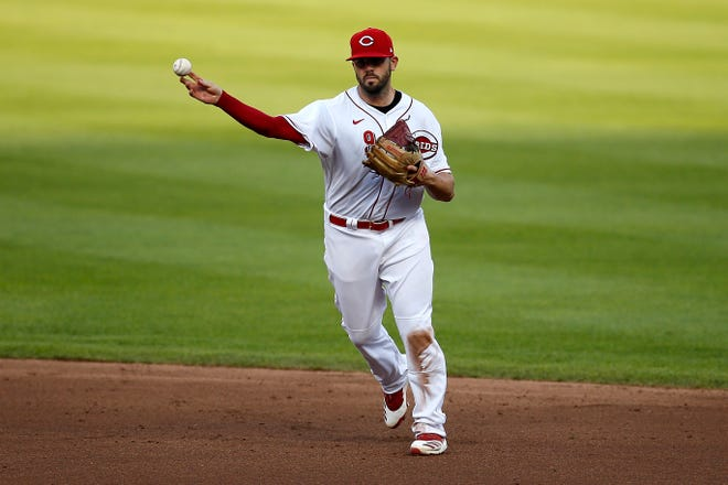 Cincinnati Reds second baseman Mike Moustakas throws to first for an out in the fourth inning vs. the Detroit Tigers at Great American Ball Park in Cincinnati on Friday, July 24, 2020.