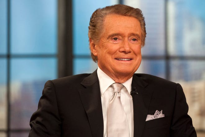 "FILE - In this Nov. 18, 2011 file photo, Regis Philbin appears on his farewell episode of ""Live! with Regis and Kelly"", in New York. Philbin, the genial host who shared his life with television viewers over morning coffee for decades and helped himself and some fans strike it rich with the game show ""Who Wants to Be a Millionaire,"" has died on Friday, July 24, 2020."