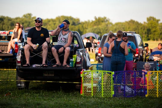 RAGBRAI riders and attendees listen to The Pork Tornadoes play a drive-in concert on July 24, 2020 at Water Works Park. The show was the second-to-last day of 2020's socially-distanced 'Virtual RAGBRAI.'