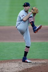 Tigers pitcher Matthew Boyd winds up before throwing a pitch in the second inning against the Cincinnati Reds at Great American Ball Park in downtown Cincinnati on Friday, July 24, 2020.