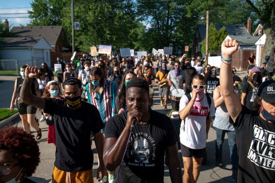 Protesters march for Priscilla Slater in Harper Woods on July 24, 2020.