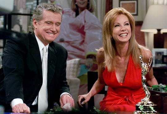 "In this July 28, 2000 file photo, Kathie Lee Gifford and co-host Regis Philbin reminisce during her last appearance on the show, in New York. Philbin, the genial host who shared his life with television viewers over morning coffee for decades and helped himself and some fans strike it rich with the game show ""Who Wants to Be a Millionaire,"" has died on Friday."