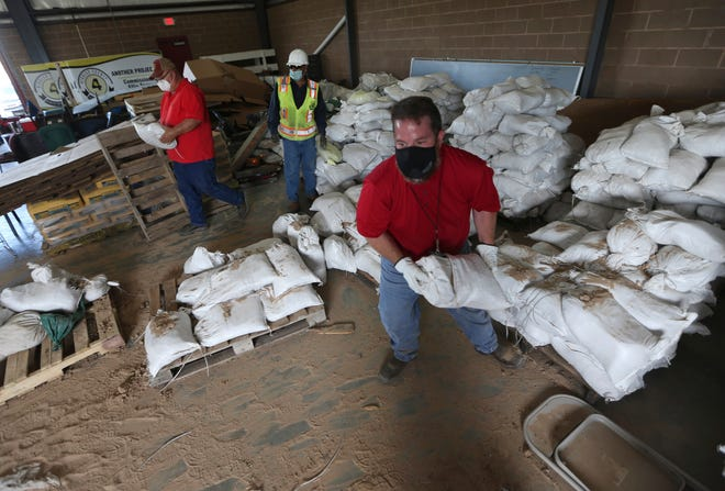 Tony Forina Hidalgo County Precinct 4 External Operations Director and other employees from the precinct load sand bags on Friday, July, 24, 2020, in Edinburg, Texas.