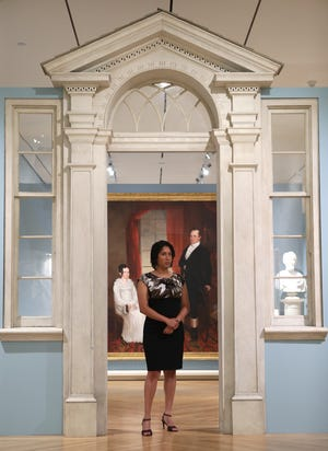 Toya Northington, with the Speed Museum, poses in the Kentucky Gallery at the museum on Friday, July 24, 2020.  Northington wishes that the gallery showed diversity.