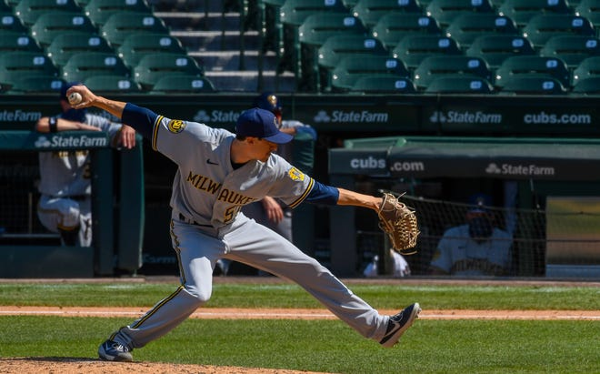 Brewers relief pitcher Eric Yardley  delivers a pitch in the ninth inning.