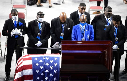 "Members of John Lewis' fraternity, Phi Beta Sigma, pay their respects after ""The Boy From Troy"" memorial service celebrating the civil rights icon and U.S. Congressman at Trojan Arena Saturday, July 25, 2020 in Troy, Ala."