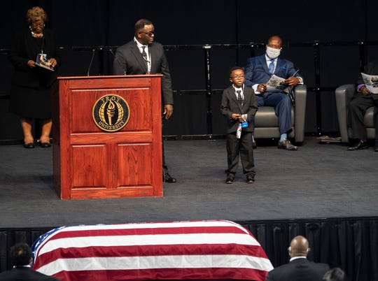Jaxon Lewis Brewster speaks during the memorial services for his Great Uncle Congressman John Lewis at Trojan Arena in Troy, Ala., on Saturday, July 25, 2020.