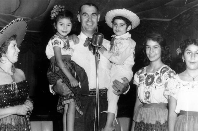 "The Marmolejo family with Frank Bogert,  c. 1940s. Rafaela Marmolejo, Cydronia Valdez, Frank Bogert, Omar Valdez, during ""Mexican Night"" at the Chi Chi."