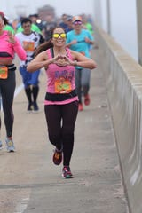 Jennifer Gomez runs in the Pensacola Double Bridge Run. With many local races canceled, Gomez said she has enjoyed participating in a virtual challenge by RunPensacola.com.