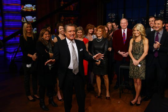 "Regis Philbin, center, and Kelly Ripa, right, on the set during Philbin's final show of ""Live! With Regis and Kelly"" on Nov. 18, 2011, in New York."